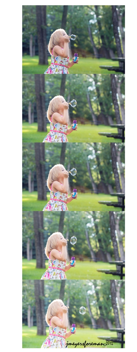 blonde girl blowing bubbles in the park
