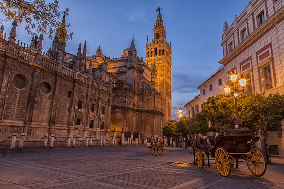 Seville Cathedral and Giralda at the Plaza del Triunfo Seville Spain